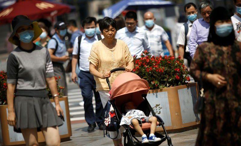 الصين تسجل 9 إصابات جديدة بكورونا