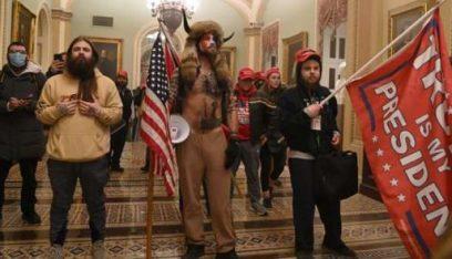 وسائل اعلام اميركية: تجمع عشرات المسلحين أمام برلمان ولاية ميشيغن بأميركا