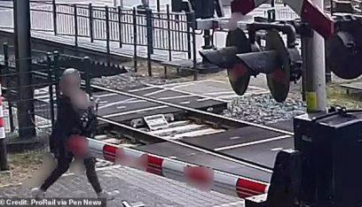 بالفيديو: 5 ثوان تنقذ حياة امرأة من قطار سريع!